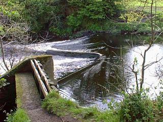 The old weir, now badly repaired